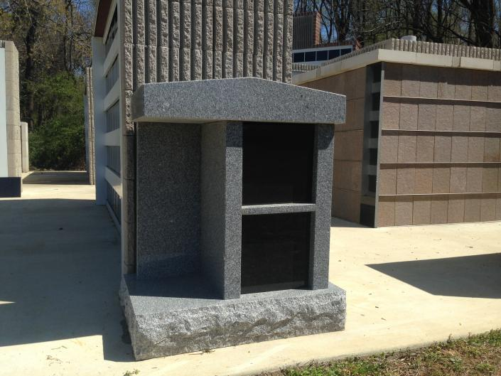 [Image: This granite mausoleum comes with a touch of black marble perfect for custom engraving. ]